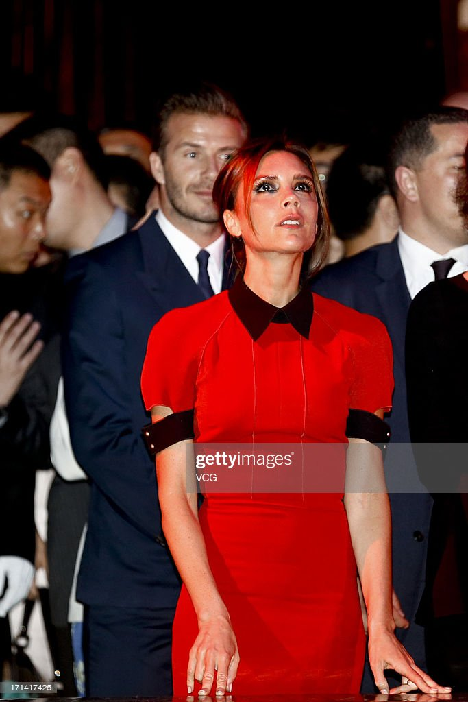 <a gi-track='captionPersonalityLinkClicked' href=/galleries/search?phrase=David+Beckham&family=editorial&specificpeople=158480 ng-click='$event.stopPropagation()'>David Beckham</a> and <a gi-track='captionPersonalityLinkClicked' href=/galleries/search?phrase=Victoria+Beckham&family=editorial&specificpeople=161100 ng-click='$event.stopPropagation()'>Victoria Beckham</a> watch Peking Opera during a reception at Reignwood Center on June 23, 2013 in Beijing, China.