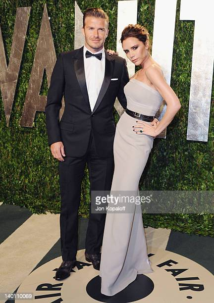David Beckham and wife Victoria Beckham arrive at the 2012 Vanity Fair Oscar Party at Sunset Tower on February 26 2012 in West Hollywood California