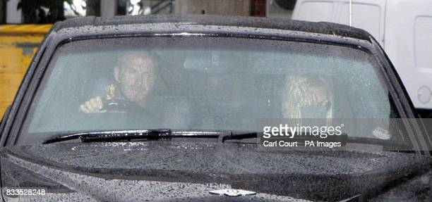 CROP David Beckham and wife Victoria leave London Chest Hospital in Bethnal Green after visiting Ted Beckham who suffered a heart attack two days ago
