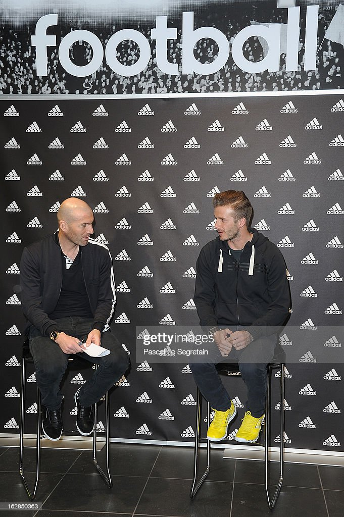 David Beckham (R) and Zinedine Zidane attend an autograph session at adidas Performance Store Champs-Elysees on February 28, 2013 in Paris, France.
