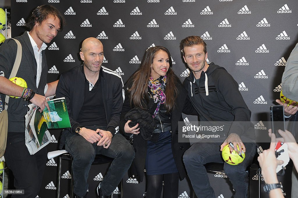 David Beckham (2nd R) and Zinedine Zidane (2nd L) pose with fans as they attend an autograph session at adidas Performance Store Champs-Elysees on February 28, 2013 in Paris, France.