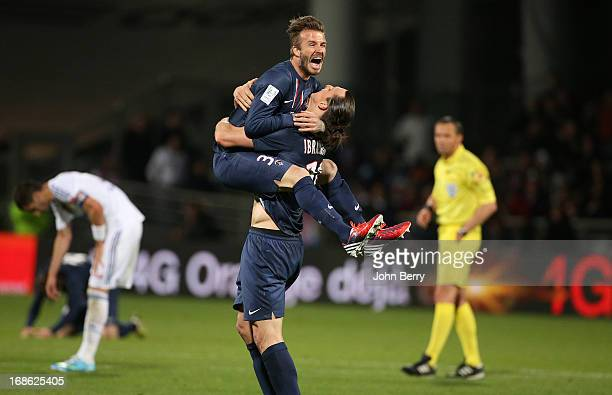 David Beckham and Zlatan Ibrahimovic of PSG celebrate the french Ligue 1 title of PSG after the Ligue 1 match between Olympique Lyonnais OL and Paris...