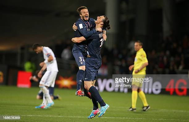 David Beckham and Zlatan Ibrahimovic of PSG celebrate the french Ligue 1 championships title of PSG after the Ligue 1 match between Olympique...