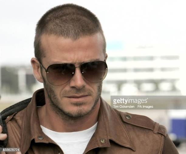 David Beckham arrives back at Heathrow Airport London after his father Ted suffered a heart attack