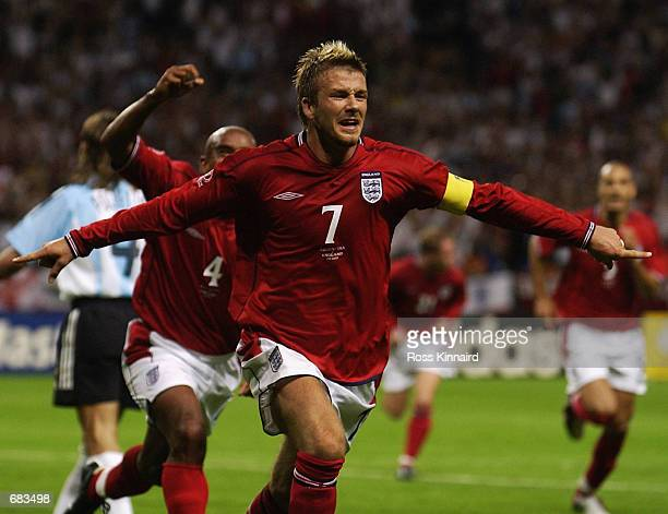 David Beckham Captain of England celebrates scoring during the Group F against Argentina at the World Cup Group Stage played at the Sapporo Dome...