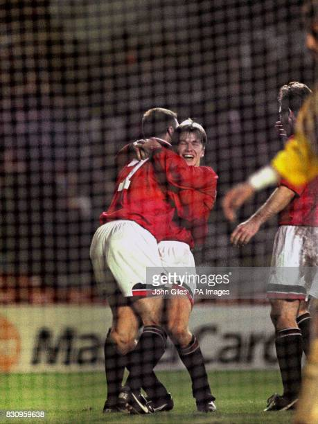 David Beckham celebrates his goal for Manchester United with teammate Eric Cantona