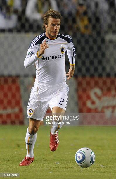 David Beckham controls the ball upon his return to the LA Galaxy side against the Columbus Crew at the Home Depot Stadium in Carson Los Angeles on...
