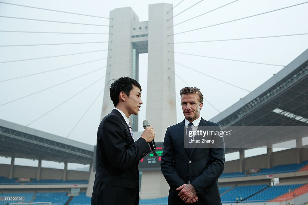 David Beckham (R) during a CCTV interview during his visit Hangzhou Huanglong Stadium on June 22, 2013 in Hangzhou, China.