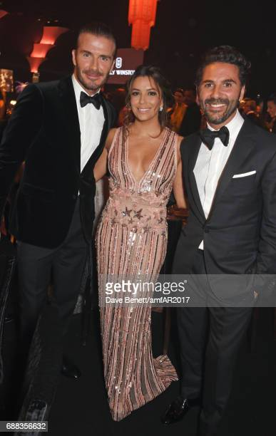 David Beckham Eva Longoria and Jose 'Pepe' Antonio Baston attend the amfAR Gala Cannes 2017 at Hotel du CapEdenRoc on May 25 2017 in Cap d'Antibes...