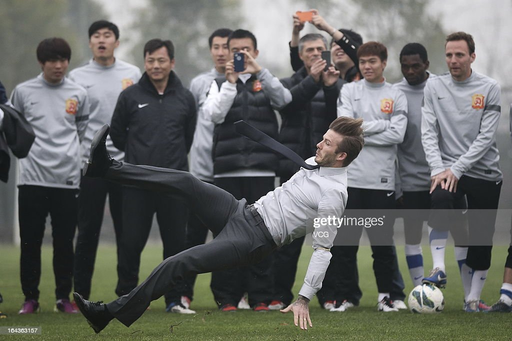 David Beckham falls during his visit to Wuhan Zall Football club on March 23, 2013 in Wuhan, Hubei Province of China.