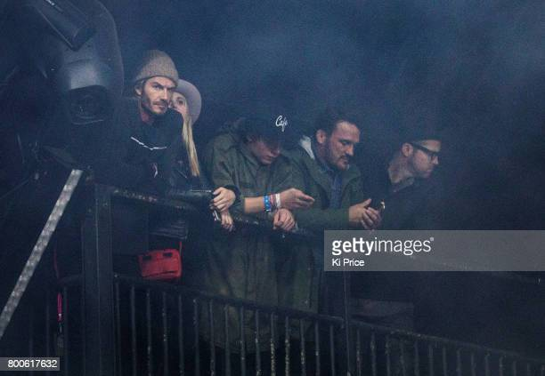 David Beckham guest Brooklyn Beckham Bobby Rich and guest watching the Foo Fighters on the Pyramid stage on day 3 of the Glastonbury Festival 2017 at...