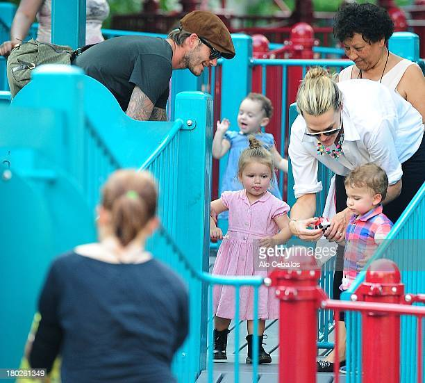 David Beckham Harper Beckham Molly Sims and Brooks Alan Stuber are seen in Vesuvio Playground in Soho on September 10 2013 in New York City