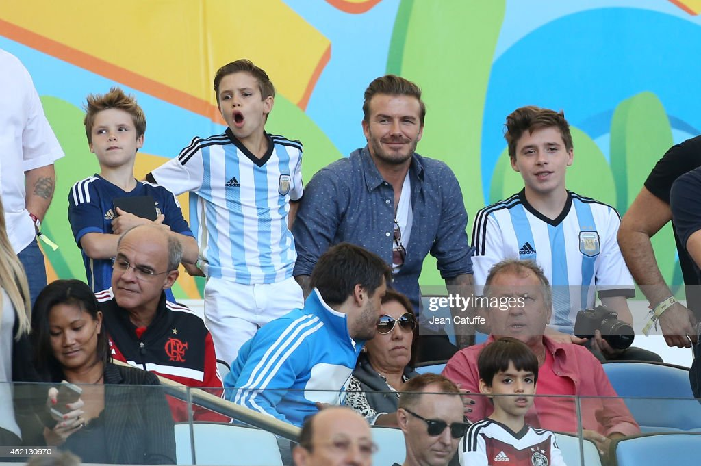 <a gi-track='captionPersonalityLinkClicked' href=/galleries/search?phrase=David+Beckham&family=editorial&specificpeople=158480 ng-click='$event.stopPropagation()'>David Beckham</a>, his sons <a gi-track='captionPersonalityLinkClicked' href=/galleries/search?phrase=Brooklyn+Beckham&family=editorial&specificpeople=214623 ng-click='$event.stopPropagation()'>Brooklyn Beckham</a>, <a gi-track='captionPersonalityLinkClicked' href=/galleries/search?phrase=Romeo+Beckham&family=editorial&specificpeople=171832 ng-click='$event.stopPropagation()'>Romeo Beckham</a>, <a gi-track='captionPersonalityLinkClicked' href=/galleries/search?phrase=Cruz+Beckham&family=editorial&specificpeople=4337497 ng-click='$event.stopPropagation()'>Cruz Beckham</a>, and <a gi-track='captionPersonalityLinkClicked' href=/galleries/search?phrase=Zico+-+Soccer+Player&family=editorial&specificpeople=243229 ng-click='$event.stopPropagation()'>Zico</a> (pink shirt) attend the 2014 FIFA World Cup Brazil Final match between Germany and Argentina at Estadio Maracana on July 13, 2014 in Rio de Janeiro, Brazil.