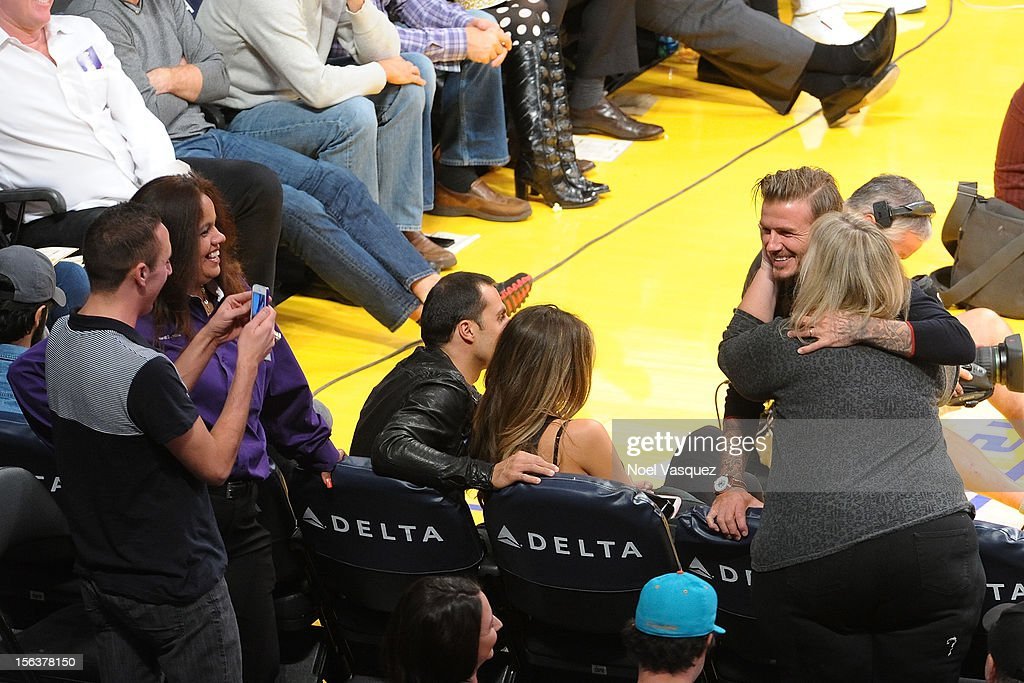 <a gi-track='captionPersonalityLinkClicked' href=/galleries/search?phrase=David+Beckham&family=editorial&specificpeople=158480 ng-click='$event.stopPropagation()'>David Beckham</a> is kissed by a fan while attending a basketball game between the San Antonio Spurs and the Los Angeles Lakers at Staples Center on November 13, 2012 in Los Angeles, California.