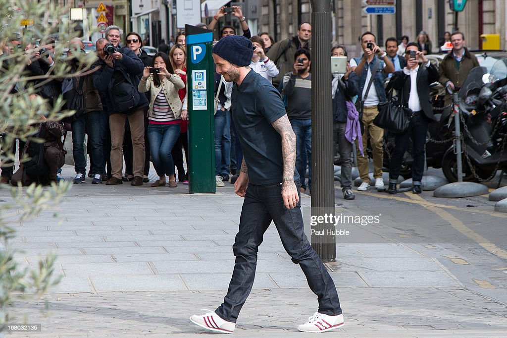 <a gi-track='captionPersonalityLinkClicked' href=/galleries/search?phrase=David+Beckham&family=editorial&specificpeople=158480 ng-click='$event.stopPropagation()'>David Beckham</a> is seen arriving at the 'Comme des garcons' store on May 4, 2013 in Paris, France.