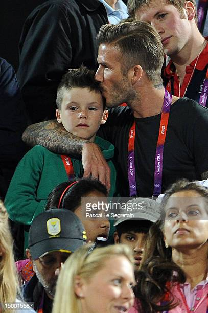 David Beckham kisses his son Cruz Beckham during the Beach Volleyball on Day 12 of the London 2012 Olympic Games at Horse Guards Parade on August 8...