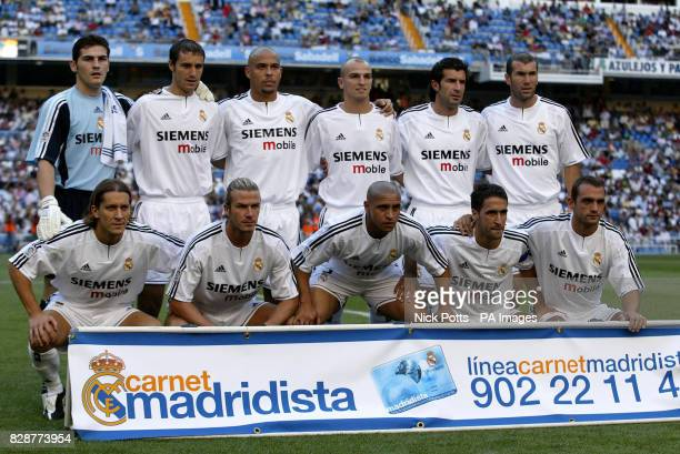 David Beckham lines up with his Real Madrid teammates ahead of his league debut for Madrid against Real Betis at the Bernabeu Stadium in Madrid Spain...