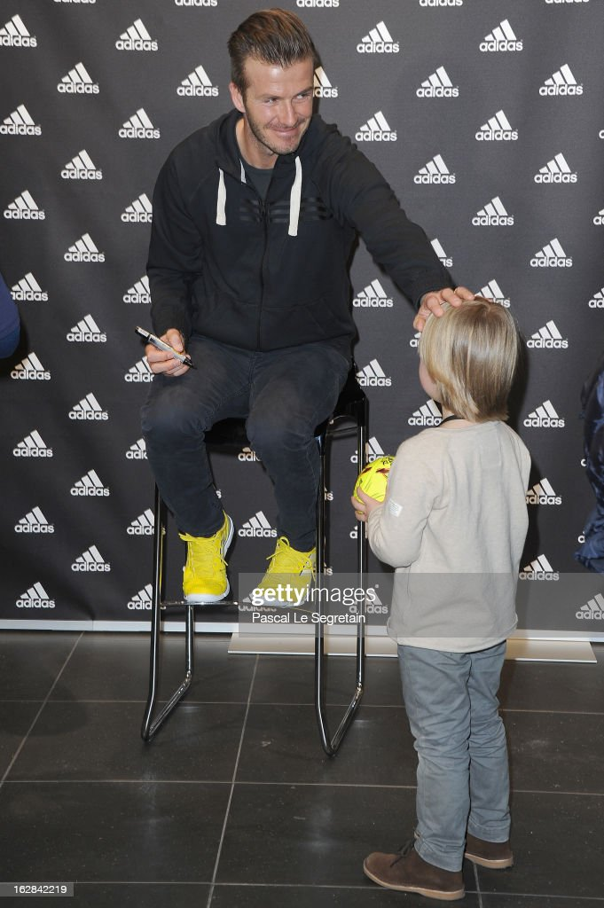 <a gi-track='captionPersonalityLinkClicked' href=/galleries/search?phrase=David+Beckham&family=editorial&specificpeople=158480 ng-click='$event.stopPropagation()'>David Beckham</a> (L) meets with a young fan as he attends an autograph session at adidas Performance Store Champs-Elysees on February 28, 2013 in Paris, France.