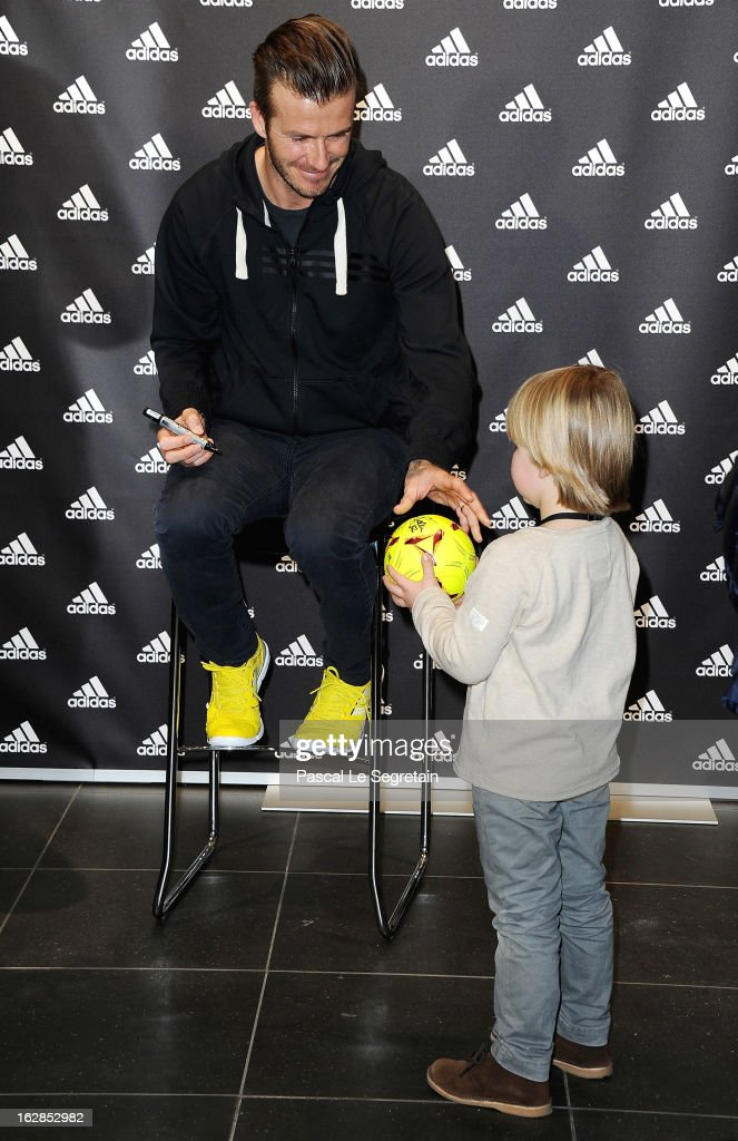 <a gi-track='captionPersonalityLinkClicked' href=/galleries/search?phrase=David+Beckham&family=editorial&specificpeople=158480 ng-click='$event.stopPropagation()'>David Beckham</a> meets with a young fan as he attends an autograph session at adidas Performance Store Champs-Elysees on February 28, 2013 in Paris, France.