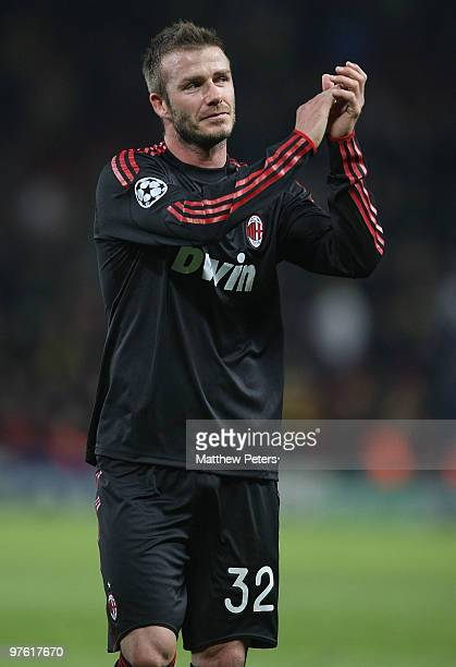 David Beckham of AC Milan applauds the fans after the UEFA Champions League First Knockout Round Second Leg match between Manchester United and AC...