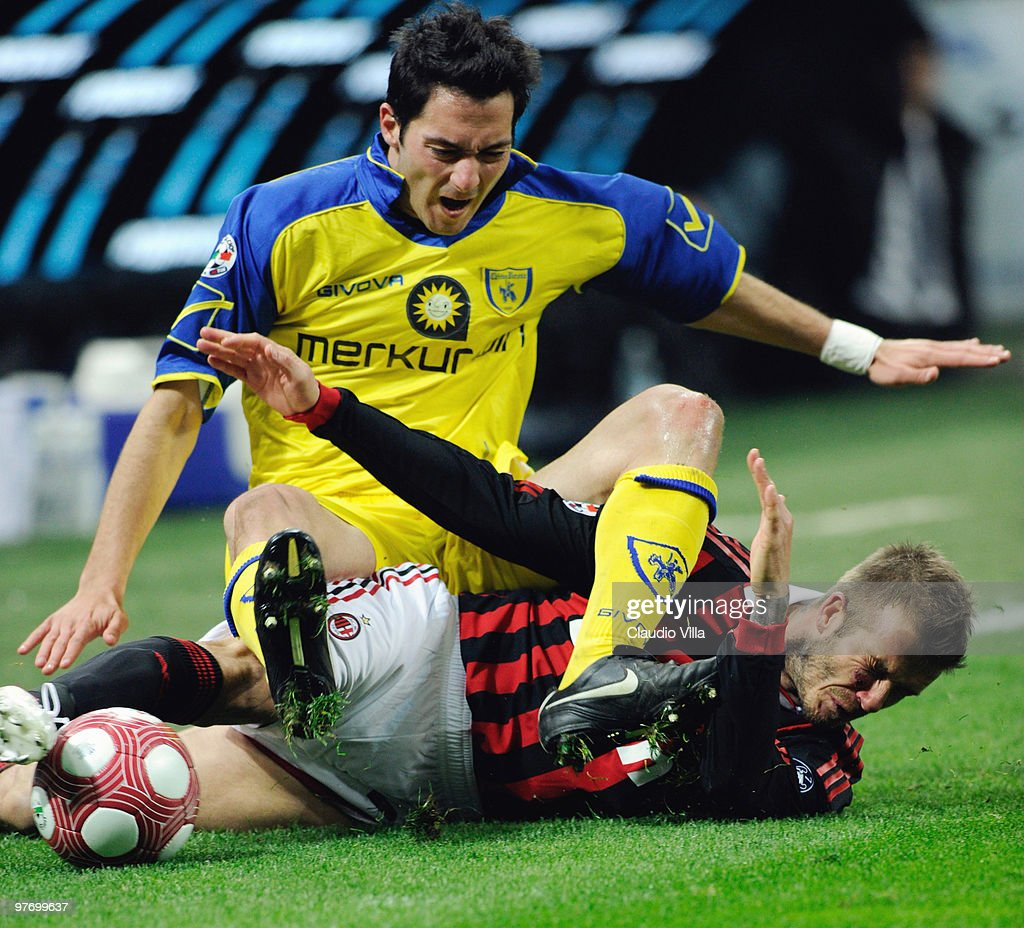 David Beckham of AC Milan competes for the ball with Andrea Mantovani of AC Chievo during the Serie A match between AC Milan and AC Chievo Verona at Stadio Giuseppe Meazza on March 14, 2010 in Milan, Italy.