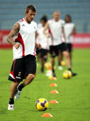 David Beckham of AC Milan in action during a training session at AlNasr's club ground on January 1 2009 in Dubai UAE