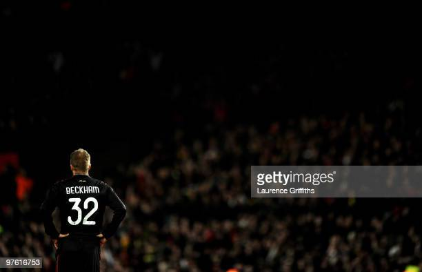 David Beckham of AC Milan looks on during the UEFA Champions League First Knockout Round second leg match between Manchester United and AC Milan at...
