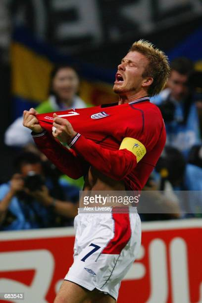 David Beckham of England celebrates after scoring the opening goal during the England v Argentina Group F World Cup Group Stage match played at the...