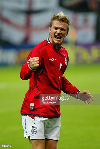 David Beckham of England celebrates scoring the first goal during the England v Argentina Group F World Cup Group Stage match played at the Sapporo...