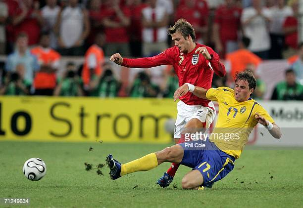 David Beckham of England is tackled by Johan Elmander of Sweden during the FIFA World Cup Germany 2006 Group B match between Sweden and England at...