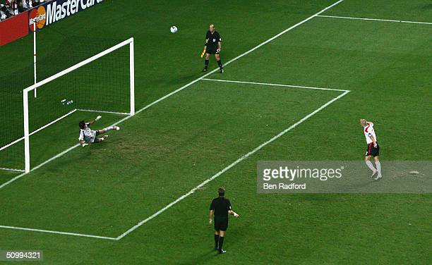 David Beckham of England puts his penalty over the bar during the UEFA Euro 2004 Quarter Final match between Portugal and England at the Luz Stadium...