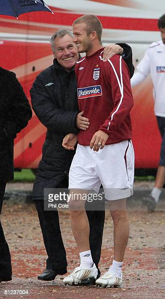 David Beckham of England shares a joke with Peter Taylor during an England training session at Arsenal's training ground on May 26 2008 in London...