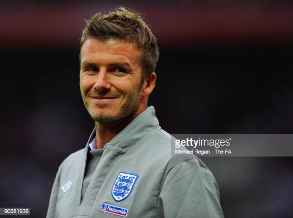 David Beckham of England smiles at fans as he warms up as a substitute during the International Friendly match between England and Slovenia at...