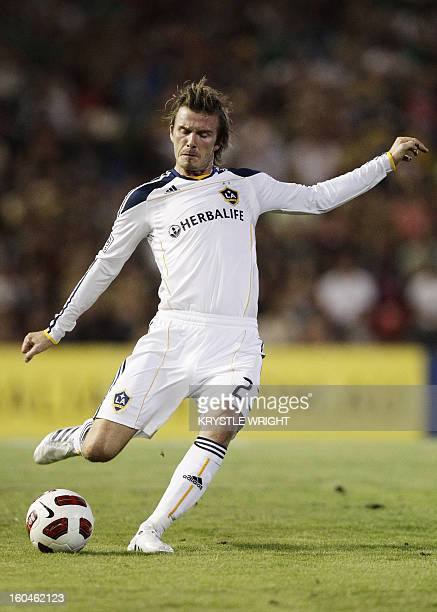 David Beckham of LA Galaxy kicks the ball during an exhibition football match against the Newcastle Jets at Energy Australia Stadium in Newcastle on...