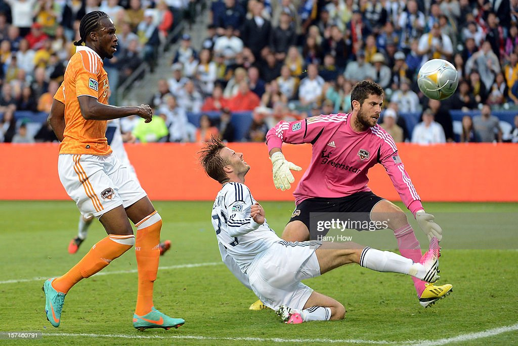 David Beckham #23 of Los Angeles Galaxy attempts a shot on goalie Tally Hall #1 of Houston Dynamo in the second half in the 2012 MLS Cup at The Home Depot Center on December 1, 2012 in Carson, California.