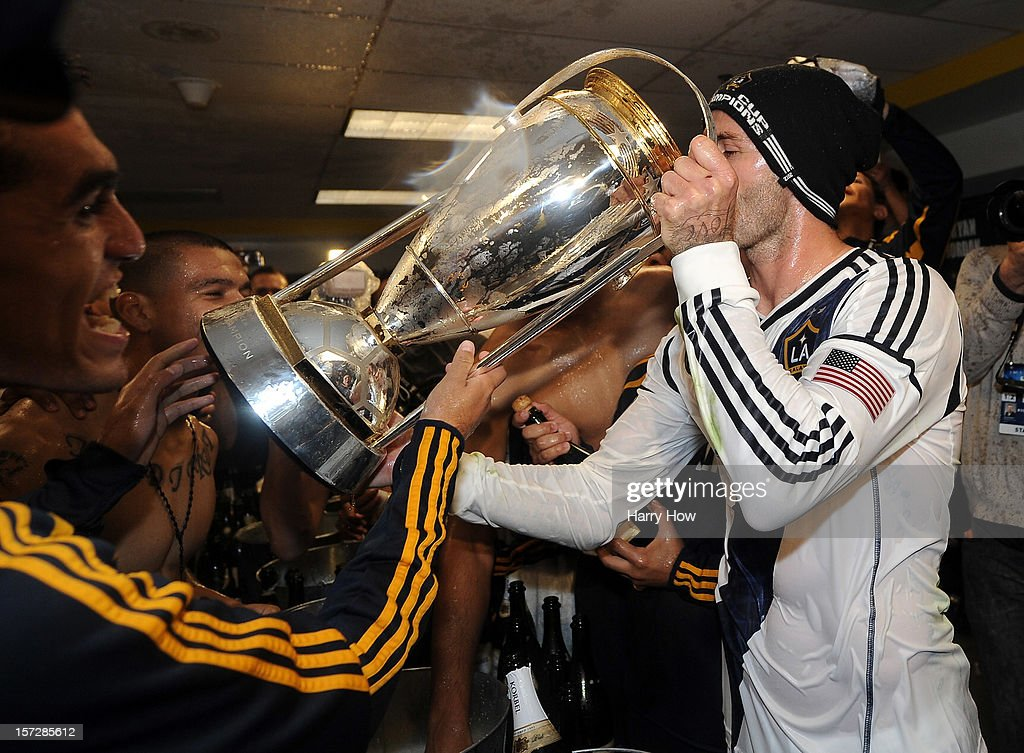 David Beckham #23 of Los Angeles Galaxy drinks out of the MLS Trophy after the Galaxy defeat the Houston Dynamo 3-1 to win the 2012 MLS Cup at The Home Depot Center on December 1, 2012 in Carson, California.