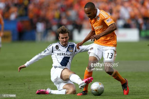 David Beckham of Los Angeles Galaxy slides for the ball against Ricardo Clark of the Houston Dynamo in the first half in the 2012 MLS Cup at The Home...