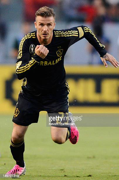 David Beckham of Los Angeles Galaxy sprints against Real Madrid during the World Football Challenge at The Home Depot Center on August 2 2012 in...