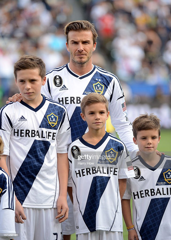 David Beckham #23 of Los Angeles Galaxy stands up the field with his sons Brooklyn, Romeo and Cruz before the Galaxy take on the Houston Dynamo in the 2012 MLS Cup at The Home Depot Center on December 1, 2012 in Carson, California.