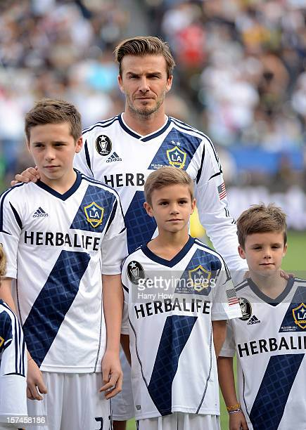 David Beckham of Los Angeles Galaxy stands up the field with his sons Brooklyn Romeo and Cruz before the Galaxy take on the Houston Dynamo in the...