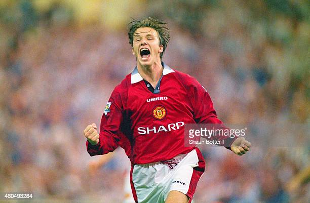 David Beckham of Manchester United celebrates after scoring the third goal in the 1996 FA Charity Shield between Manchester United and Newcastle...