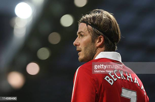 David Beckham of Manchester United in action during Gary Neville's testimonial match between Manchester United and Juventus at Old Trafford on May 24...