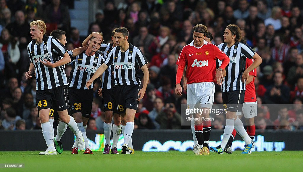 <a gi-track='captionPersonalityLinkClicked' href=/galleries/search?phrase=David+Beckham&family=editorial&specificpeople=158480 ng-click='$event.stopPropagation()'>David Beckham</a> of Manchester United looks dejected after the 2nd Juve goal during the Gary Neville Testimonial Match between Manchester United and Juventus at Old Trafford on May 24, 2011 in Manchester, England.