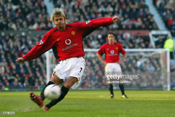 David Beckham of Manchester United scores the second goal with a trademark freekick during the FA Cup third round match between Manchester United and...