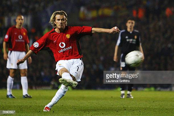 David Beckham of Manchester United scores the third goal from a free kick during the UEFA Champions League quarter final second leg match between...
