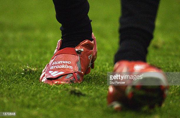 David Beckham of Manchester United with his new boots showing his two son's names Brooklyn and Romeo during the FA Barclaycard Premiership match...