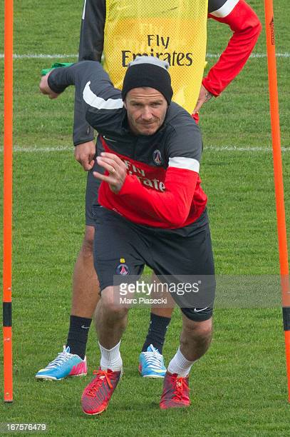David Beckham of Paris Saint Germain FC exercises during a training session at Camp des Loges on April 26 2013 in Paris France
