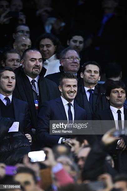 David Beckham of Paris SaintGermain looks on from the stands prior to the UEFA Champions League Round of 16 first leg match between Valencia CF and...
