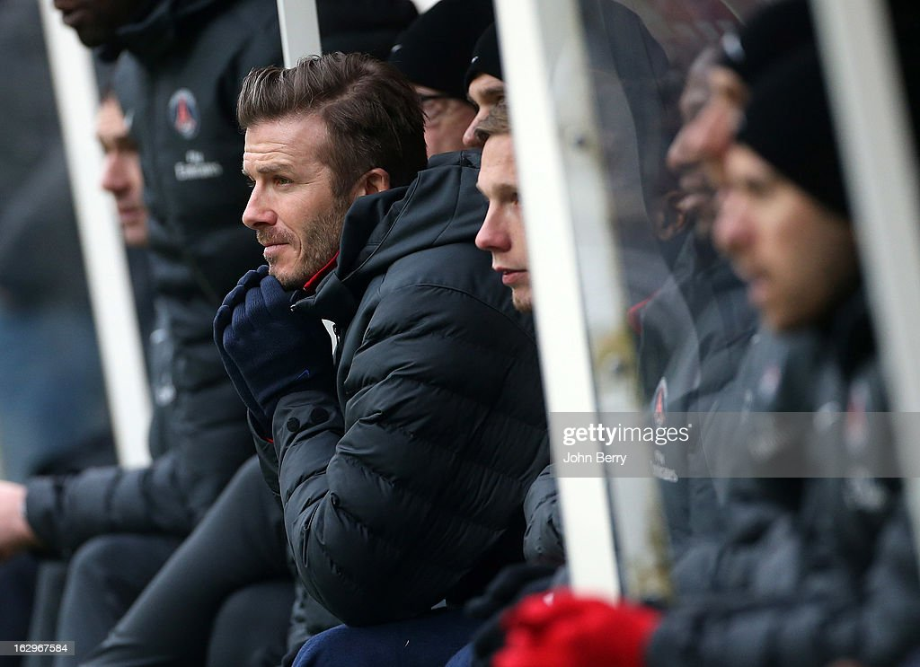 <a gi-track='captionPersonalityLinkClicked' href=/galleries/search?phrase=David+Beckham&family=editorial&specificpeople=158480 ng-click='$event.stopPropagation()'>David Beckham</a> of Paris Saint-Germain sits on the bench during the French Ligue 1 match between Stade de Reims Champagne FC and Paris Saint-Germain FC at the Stade Auguste Delaune on March 2, 2013 in Reims, France.