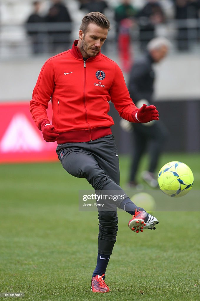 <a gi-track='captionPersonalityLinkClicked' href=/galleries/search?phrase=David+Beckham&family=editorial&specificpeople=158480 ng-click='$event.stopPropagation()'>David Beckham</a> of Paris Saint-Germain warms up before the French Ligue 1 match between Stade de Reims Champagne FC and Paris Saint-Germain FC at the Stade Auguste Delaune on March 2, 2013 in Reims, France.